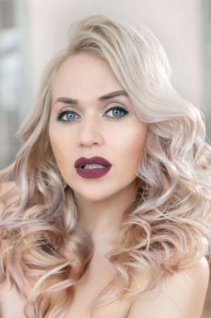 Fashion model with curls and marsala lipstick