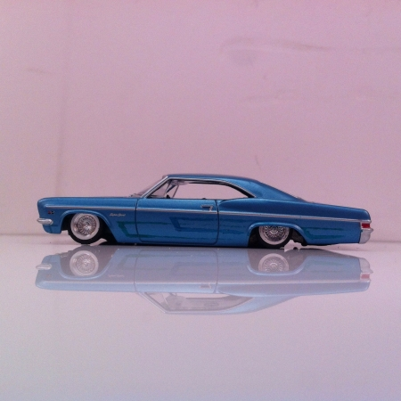 Impala: A 164 scale toy car lowrider built by me.  Stock Photo
