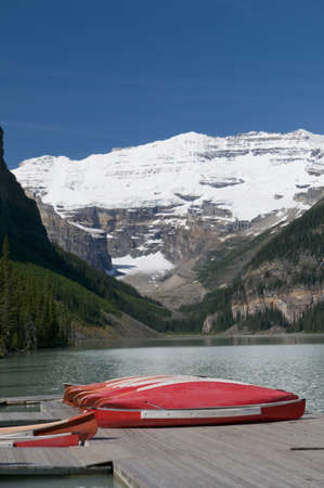 Canoes at Lake Louise with Victoria glacier in the background photo