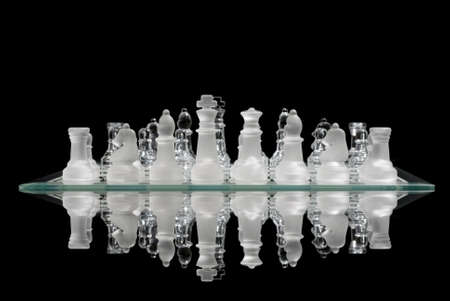 Chess game reflection with black background photo