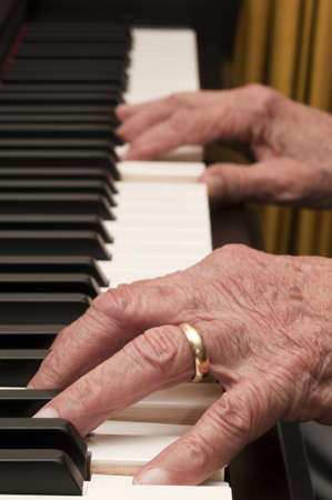 Selective focus on old hands playing the piano Stock Photo - 17857706