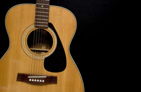 Acoustic Guitar on black background. Stock Photo - 17944382