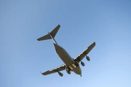 Transport plane landing with blue sky in the background