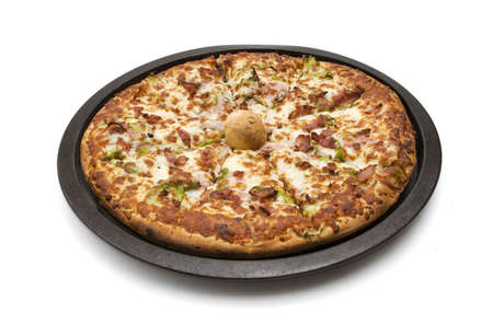 Combination pizza straight out of the oven. Stock Photo