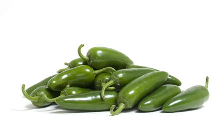 A bunch of hot jalapeno peppers on white background