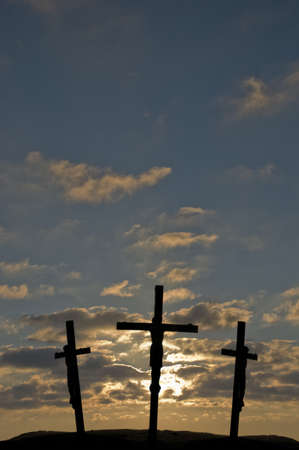 Jesus on the Cross with sunset in the background Stock Photo