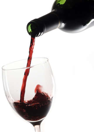 Pouring red wine in glass with white background Stock Photo - 17999765