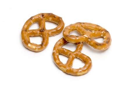 Three pretzels on white background
