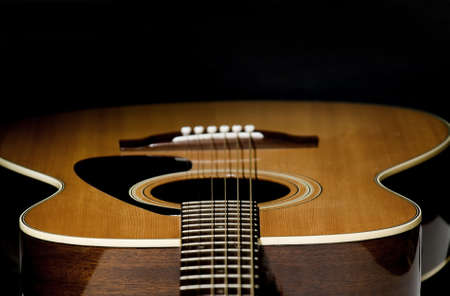 Abstract shot of the a guitar - looking down the strings, selective focus. Stock Photo - 17999781