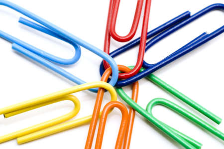 Joined multi colored paper clips on white background Stock Photo
