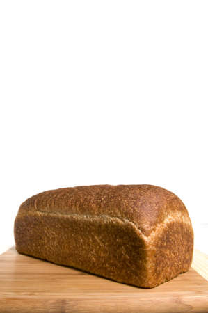 Whole wheat baked bread with large copy area on this vertical image Stock Photo