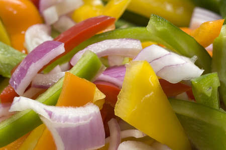 Chopped onions, green, yellow and red peppers ready for a stirfry