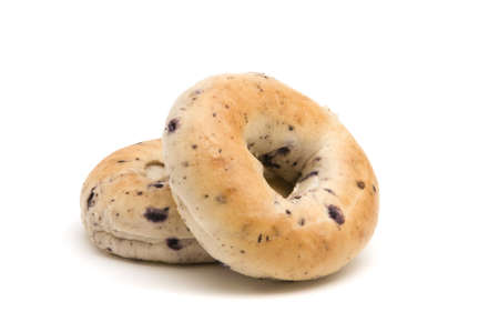 Two blueberry bagels on a white background
