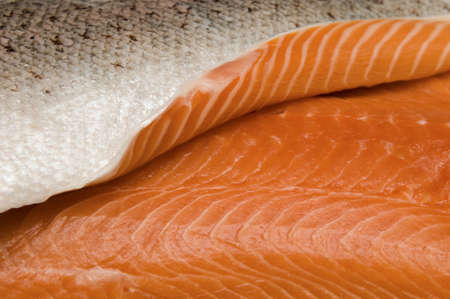 Selective focus on the edge of a fresh salmon fillet photo