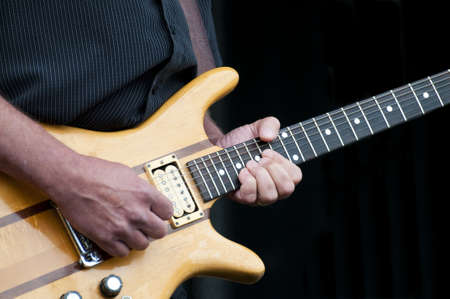 Musician playing the electric guitar at a local festival Stock Photo - 18355921