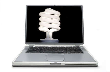 Laptop Concept - Conservation with energy saving bulb. Stock Photo - 18355797