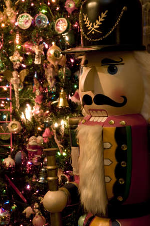 Selective focus on Nutcracker in front of Christmas tree. photo