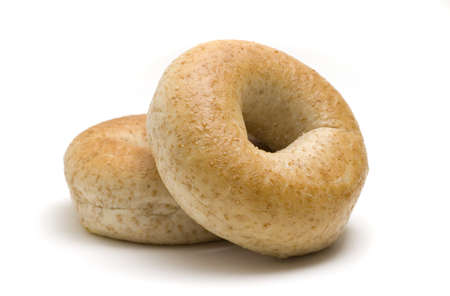 Two whole wheat bagels isolated on white background. Stock Photo