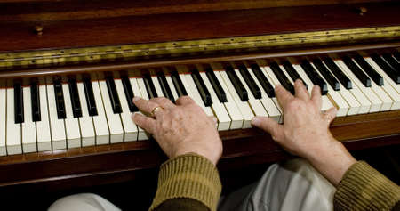 Rear flash, showing slight movement on the hands on the piano. photo