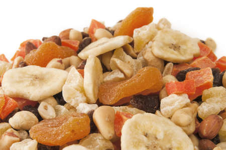 mixed fruit: Mountain of Trail Mix with copy space white at the top with selective focus on the center area of the dried fruit and nuts