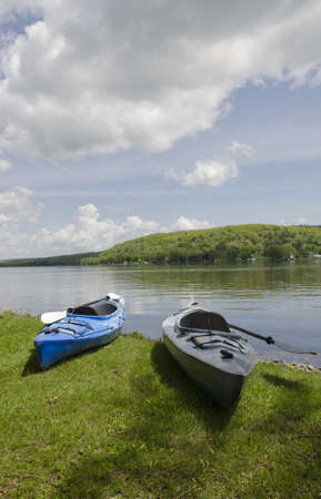 Two kayaks on the shoreline with the lake in the background photo