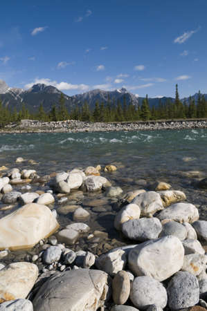 Boulders in the foreground of the Snaring River in Jasper National Park photo