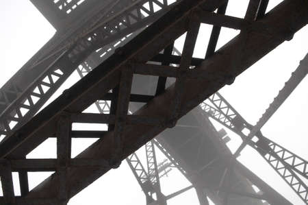 girders: High contrast abstract image of steel girders used in a train bridge on a foggy morning Stock Photo