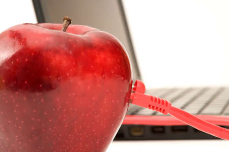 Red Apple connected to a laptop with an ethernet cable photo