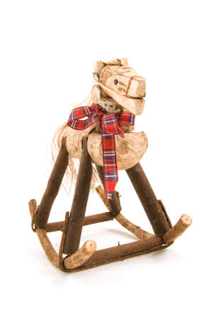 Handcrafted rocking horse on white background