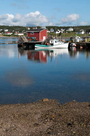 lobster boat: Lobster boat reflection in the harbour on a summer morning, located in Nova Scotia, Canada