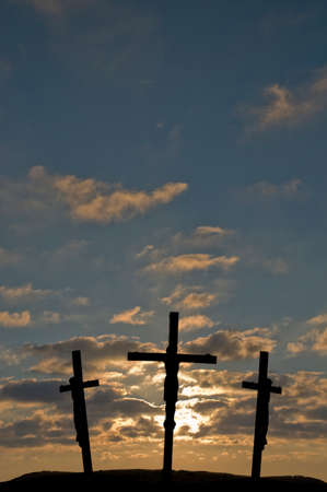 christian crosses: Jesus on the Cross with sunset in the background Stock Photo