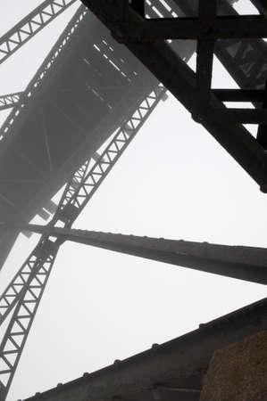 girder: Abstract steel girder of a train bridge in the fog