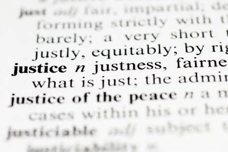fair trial: Dictionary macro photo with selective focuse on the word Justice