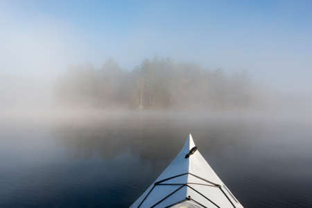 Kayaling in the fog on a northern lake in October