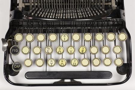 repurpose: Old typewriter keys rearranged to say I LOVE YOU