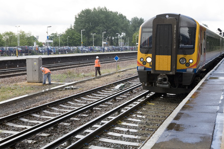 south west england: A commuter train approaches a platform in South West England Editorial