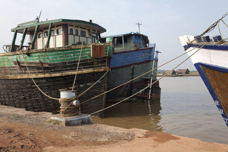 rennovation: Old wooden cargo boats undergoing rennovation at shipyard, Mangalore, India