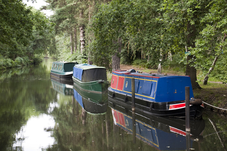 tether: Colourful long boats on Basingstoke Canal in Surrey, England