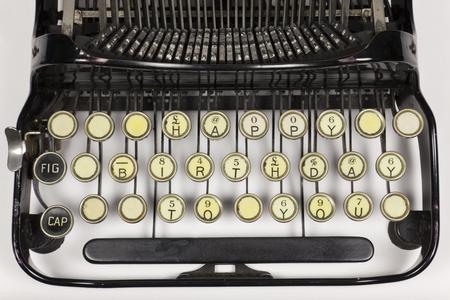 repurpose: Old typewriter keys rearranged to say HAPPY BIRTHDAY