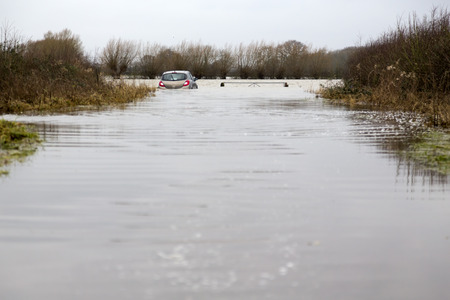 abandoned car: Car abandoned trapped in flood water, Somerset Levels, England