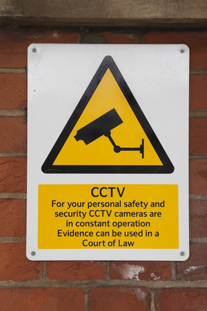vicinity: Sign on wall warning of CCTV cameras operating in vicinity