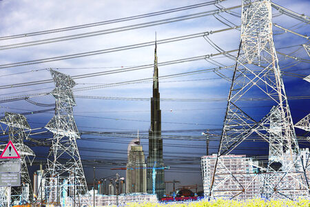 adjusted: Heavily adjusted landscape of Dubai skyline with myriad of electricity pylons