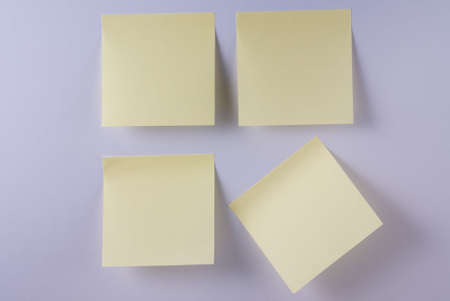 posting: 4 blank yellow adhesive notes on mauve background with one at angle. See others like this. Stock Photo