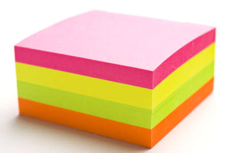 Multi colored post it note block with narrow depth of field