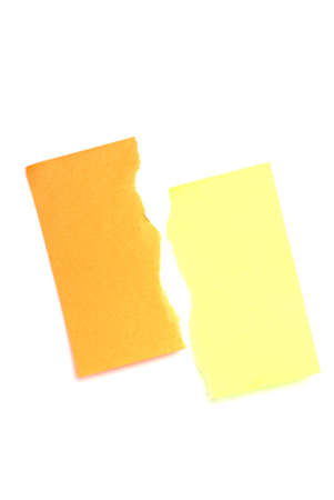 notelet: Post it notes. Orange and yellow. Torn in half.
