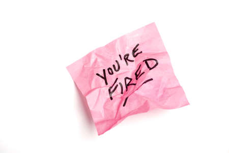 notelet: Pink post it note isolated on white with youre fired written.