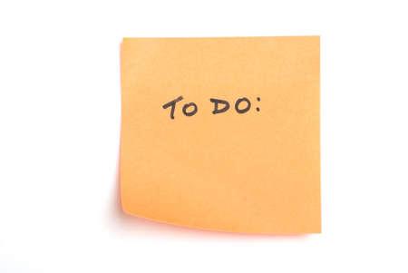 """Puesto que la nota de color naranja aislada sobre blanco con """"hacer"""" por escrito."""