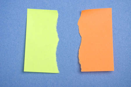 notelet: Post it notes torn. Concept for difference or disagreement or anger. Stock Photo