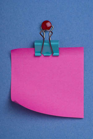 notelet: Pink postit note on blue background with red thumb tack and green clip.