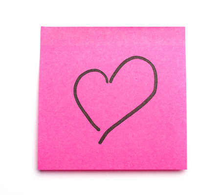 notelet: Post it note with heart symbol as concept for office romance. Suitable for St Valentines Day